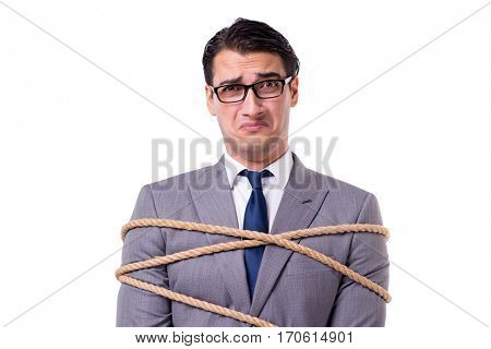 Businessman tied up with rope isolated on white