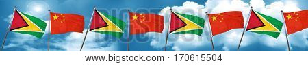 Guyana flag with China flag, 3D rendering