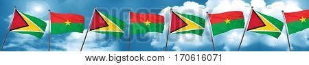 Guyana flag with Burkina Faso flag, 3D rendering