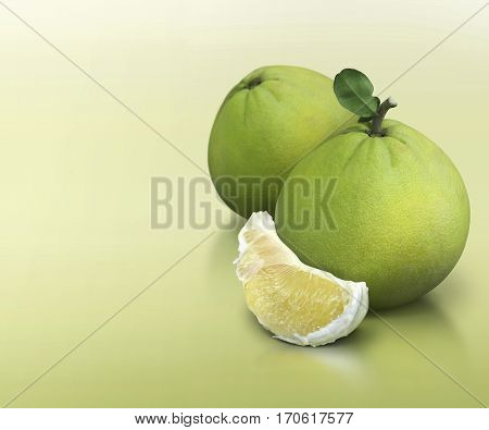 Green pomelo group on green solid background