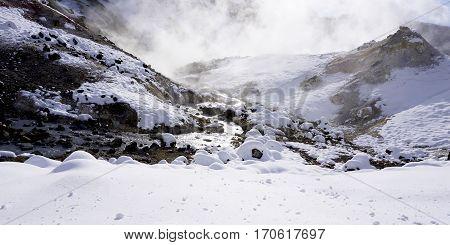 Closeup Stone And Stream In The Mist Noboribetsu Onsen Snow Winter Panorama