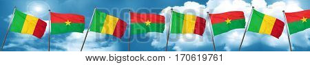 Mali flag with Burkina Faso flag, 3D rendering