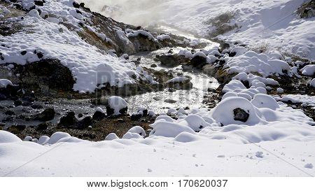 Closeup Stone And Stream In The Mist Noboribetsu Onsen Snow