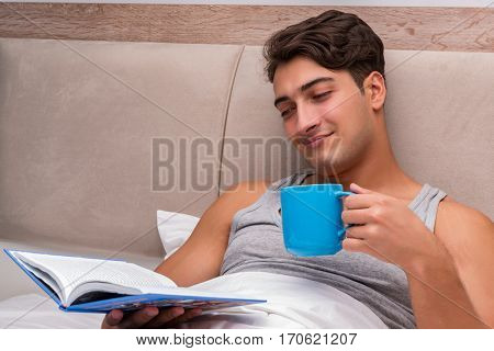 Man reading book in the bed