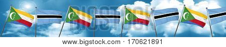 Comoros flag with Botswana flag, 3D rendering