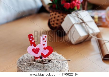 Colorful heart of pin and gifts on the desk.