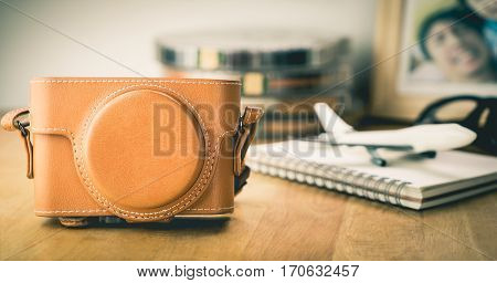 Travel blogger camera with picture page on desk