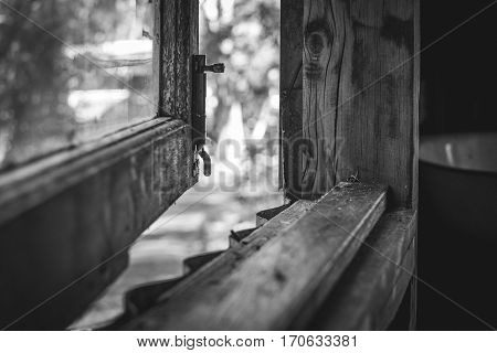 Looking through a rustic timber window black and white