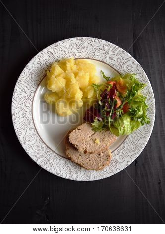 Meat loaf with potatos  on white plate , vegetables  salad. Delicious meal of minced meat