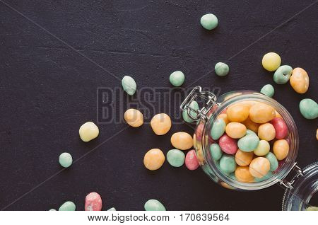 Colorful Candies In A Jar On A Dark Background