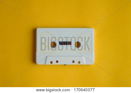 Old Audio Tape On A Yellow Background. Music Concept