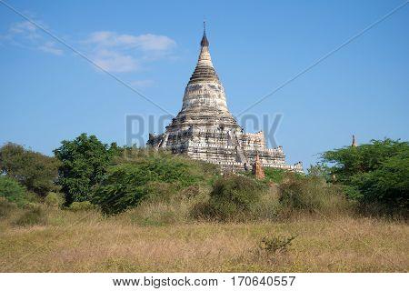 The ancient Buddhist stupa Shwesandaw. Sunny day. Bagan, Myanmar