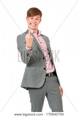 Angry or furious businessman in grey suit show middle finger or fuck you sign, isolated on white background.