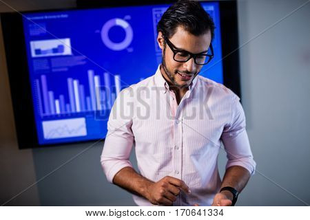 Businessman pretending to use a smartphone in studio