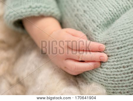 lovely little hand of newborn baby with tiny fingers anf nails, closeup