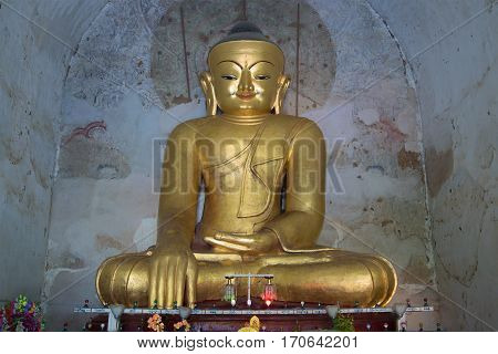 BAGAN, MYANMAR - DECEMBER 23, 2016: Sculpture of a seated Buddha in the ancient temple Gawdaw-palin