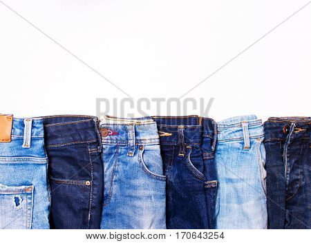 Jeans blue in a row on a white background. texture of denim