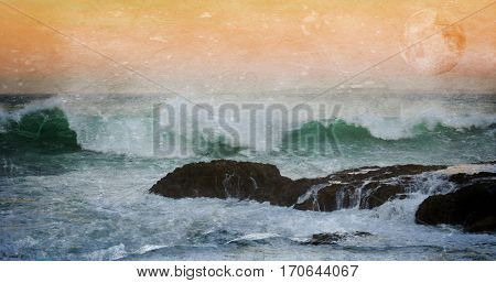 Seascape with rocky coast and waves at dawn