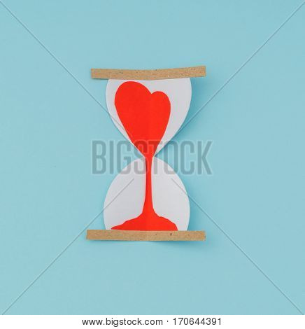 Paper cut of Hearts in Sand Clock