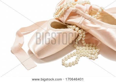 Ballet pointe shoes isolated on white with pearl