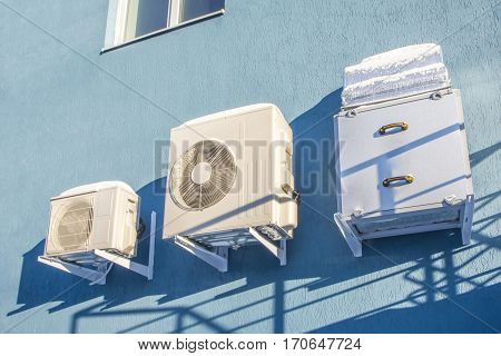 Air conditioners in the wall of a house