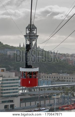 JUNE 18 2011 - BARCELONA SPAIN: cable car transportation in Barceloneta at cold rainy day