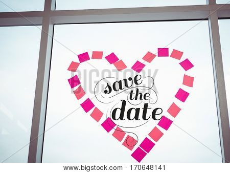 Save the date graphic on window in heart shape