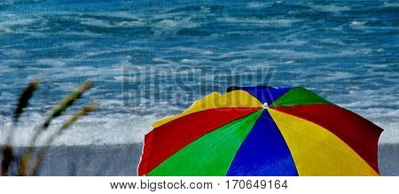 Landscape with colorful beach umbrella and the Sea