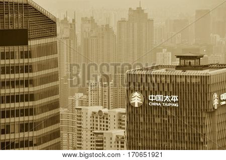 SHANGHAI CHINA - MARCH 20: Pudong district skyscrapers on March 20 2016 in Shanghai China. Pudong is a district of Shanghai located east of the Huangpu River. Sepia Toned Photo.