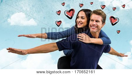 Digital composite image of man giving piggy back to woman with hearts