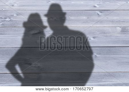 Portrait of smiling couple against bleached wooden planks background