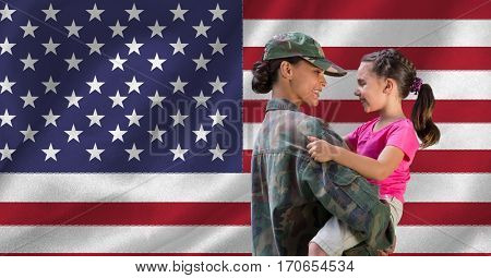 Mother in soldier uniform carrying her daughter against american flag
