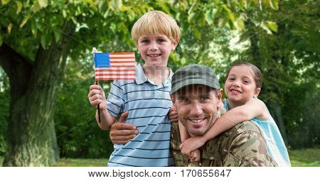 Portrait of father in soldier uniform with their kids at park on a sunny day
