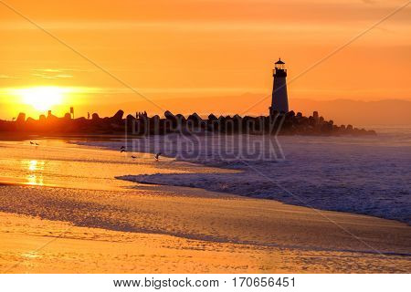 Santa Cruz Breakwater Light (Walton Lighthouse) at sunrise, Pacific coast, California, USA