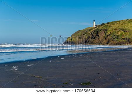 North Head Lighthouse at Pacific coast, Cape Disappointment, built in 1898, WA, USA. Coast guard helicopters in the sky.