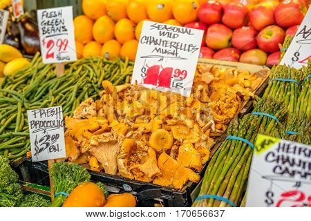 Fresh organic mushrooms, fruits and vegetables at farmers marketplace