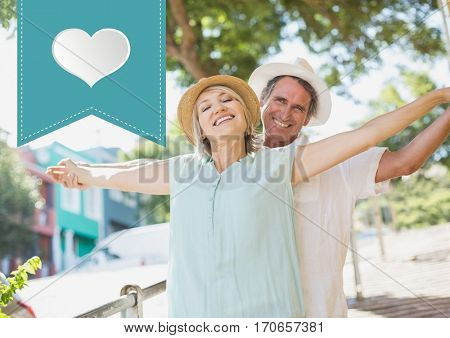 Composite image of mature couple standing with arms outstretched