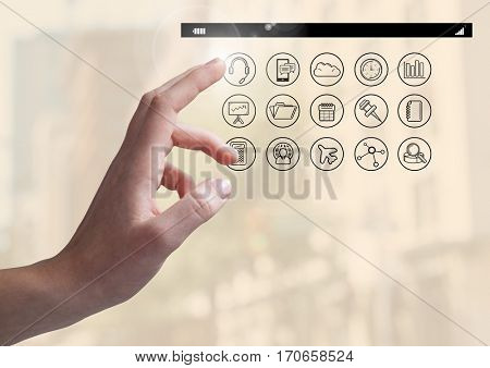 Close-up of hand touching digitally generated application apps