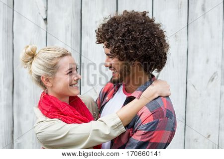 Happy young couple embracing each other
