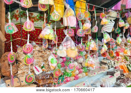 Lollipops and sweets sale at Candy stand in Flores, Guatemala.