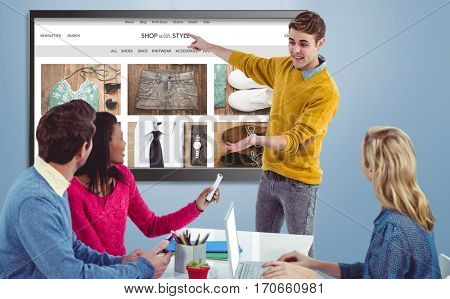 Creative businessman giving a presentation against website frontpage