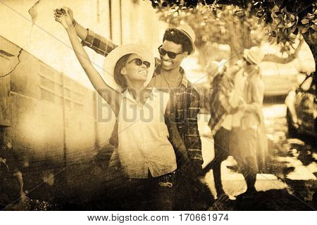 Grey background against young couple dancing on roadside