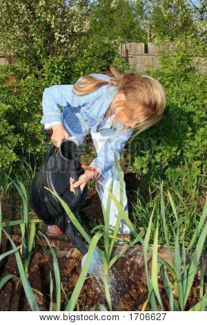 Girl Working In The Garden