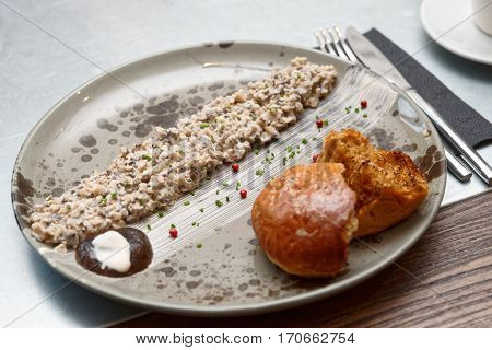 Mushroom caviar and grilled brioche on plate, Nordic cuisine dish
