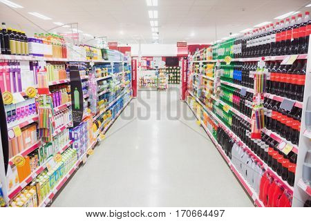 Facing view of an aisle in supermarket