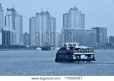 SHANGHAI CHINA - MARCH 25: Pudong district view from The Bund waterfront area on March 25 2016 in Shanghai China. Pudong is a district of Shanghai located east of the Huangpu River. Blue toned photo