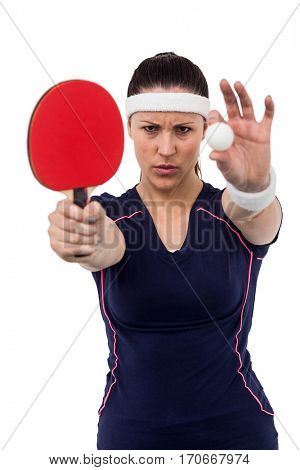 Female athlete holding table tennis paddle and ball on white background