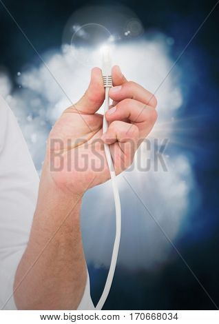 Close-up of man hand with cable and flare against digitally generated cloud