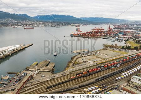 Vancouver Canada - January 28 2017: Vancouver Port with hundreds of shipping containers and mountains in the background