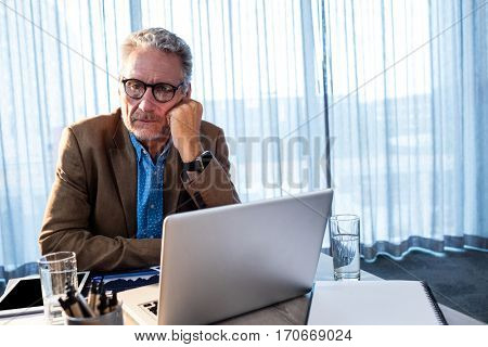 Businessman at office looking sad